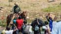 Un agent de la police des frontières américaine sur son cheval devant des immigrants traversant le Rio Grande, le 19 septembre 2021