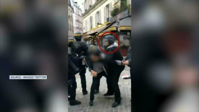 Alexandre Benalla portait un casque et un brassard de policier.