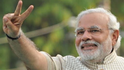 """Narendra Modi, 63 ans, veut ouvrir une """"nouvelle ère"""" pour l'Inde, alors que son parti nationaliste hindoue a remporté les élections au détriment du Parti du Congrès."""