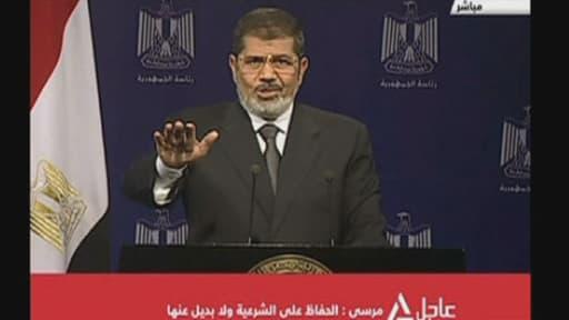 """Mohamed Morsi s'est exprimé à la télévision égyptienne mardi soir, martelant sa """"légitimité"""" au pouvoir."""