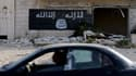 Un drapeau islamique peint sur une usine détruite à Alep, en Syrie (photo d'illustration)