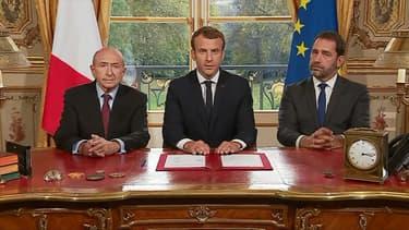 Emmanuel Macron aux côtés de Gérard Collomb et Christophe Castaner, ce lundi à l'Elysée.