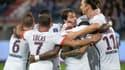 Les joueurs du PSG fêtent un but contre Caen