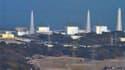 Les autorités japonaises ont annoncé samedi que la situation se stabilisait dans le réacteur n°3 de la centrale nucléaire de Fukushima-Daiichi. /Photo prise le 13 mars 2011/ REUTERS/Kyodo