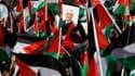Le président de l'Autorité palestinienne Mahmoud Abbas a été accueilli dimanche par une foule en liesse à son retour à Ramallah, en Cisjordanie, trois jours après le vote de l'Onu qui a accordé le statut d'Etat non-membre observateur à la Palestine. /Phot