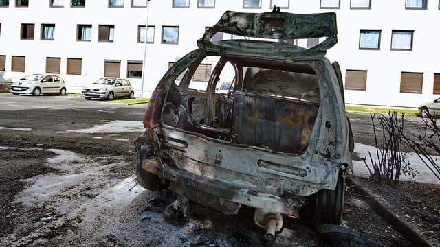 Près de 900 voitures ont été incendiées lors des soirées des 13 et 14 juillet en France (Photo d'illustration datant de 2009)
