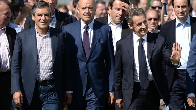 François Fillon, Alain Juppé et Nicolas Sarkozy à l'université d'été des Républicains le 5 septembre, à La Baule.