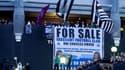 Des supporters de Newcastle célèbrent la vente du club
