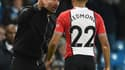 Pep Guardiola et Nathan Redmond