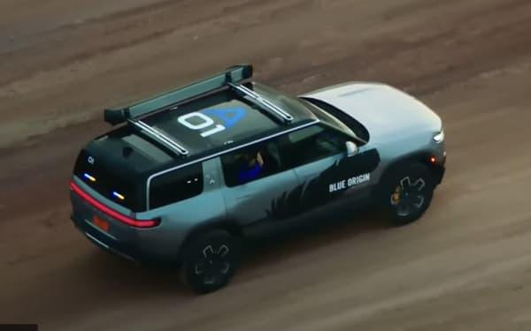All-electric Rivian SUV and Blue Origin passenger transport.