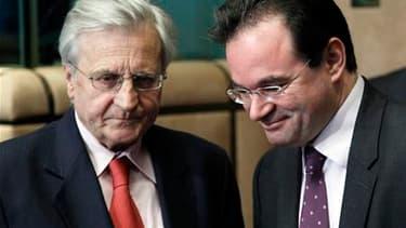 Le président de la Banque centrale européenne, Jean-Claude Trichet (à gauche), en compagnie du ministre grec des Finances George Papaconstantinou à Bruxelles. Une semaine après avoir décidé d'un plan massif de stabilisation de la zone euro, l'Eurogroupe a