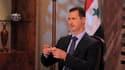 Le président syrien Bachar al Assad a annoncé dimanche à la télévision que des élections législatives auraient lieu en février prochain, après une série de réformes instaurant le multipartisme. /Image diffusée le 21 aout 2011/REUTERS/Sana/Handout