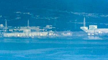 Vue aérienne de la centrale de Fukushima-Daiichi. Les barres de combustible dans les réacteurs 1, 2 et 3 sont endommagées et des fuites sont hautement probables à travers les enceintes de confinement, a déclaré mardi l'agence japonaise de sûreté nucléaire