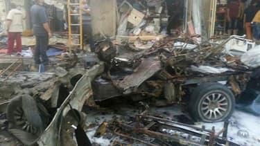 Des attentats à la voiture piégée sur des marchés et dans des rues commerçantes de Bagdad et ses environs ont fait plus de 50 morts et une centaine de blessés mardi. /Photo prise le 6 août 2013/REUTERS