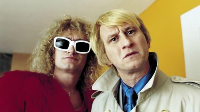 """Jean-Paul Rouve et Benoît Poelvoorde dans """"Podium"""" en 2004."""