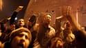 Manifestants place Tahrir, dans le centre du Caire, pendant la retransmission du discours télévisé de Hosni Moubarak. Le président égyptien a annoncé qu'après 30 ans de règne, il ne briguerait pas un septième mandat lors de la prochaine présidentielle en
