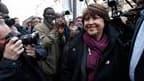"""Le Premier secrétaire du PS, Martine Aubry, à son arrivée rue de Solferino. Responsabilité"""", """"obligation"""", """"devoir"""": les dirigeants du Parti socialiste ont accueilli la victoire de la gauche aux élections régionales avec solennité, à deux ans de la procha"""