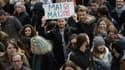 Des manifestants protestant contre les réformes du gouvernement à Paris ce jeudi 22 mars.