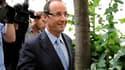 François Hollande s'est rendu mercredi à 15H00 au siège de la Brigade de la répression de la délinquance contre la personne pour être entendu dans l'affaire Tristane Banon. /Photo prise le 20 juillet 2011/ REUTERS/Gonzalo Fuentes