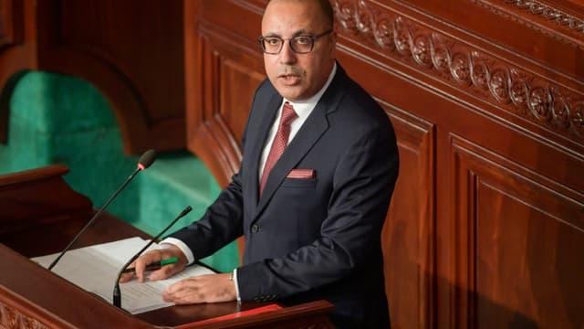 Le Premier ministre désigné Hichem Mechichi, lors d'un discours devant les députés tunisiens avant le vote de confiance au gouvernement, à Tunis, le 1er septembre 2020