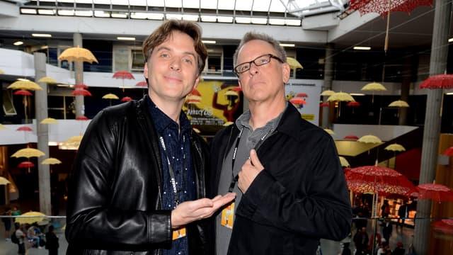 """Les réalisateurs Byron Howard et Rich Moore prennent la pose lors de la présentation du film d'animation """"Zootopie"""" lors du festival international du film d'Annecy, en juin 2015."""