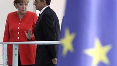 La question des Eurobonds ne figurera pas au programme de la rencontre entre Angela Merkel et Nicolas Sarkozy mardi à Paris. /Photo prise le 17 juin 2011/REUTERS/Fabrizio Bensch