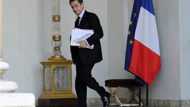 Nicolas Sarkozy a lancé mercredi en conseil des ministres un appel à la lucidité et au sang-froid face à la crise nucléaire du Japon. /Photo prise le 16 mars 2011/REUTERS/Gonzalo Fuentes