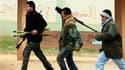 Insurgés libyens à Benghazi. Bravant la résolution du Conseil de sécurité de l'Onu et les préparatifs intensifs d'une intervention militaire internationale, les forces de Mouammar Kadhafi sont entrées samedi dans la ville, soumise selon les rebelles à d'i
