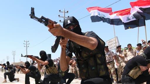 Des combattants sunnites engagés contre les partisans de l'Etat islamique en Irak, le 7 août 2014.