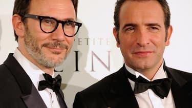 """Michel Hazanavicius et Jean Dujardin aux Oscars en 2012, l'année du triomphe de """"The Artist""""."""