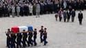 Dans la cour des Invalides, à Paris, cérémonie d'honneurs militaires pour Raymond Aubrac, l'ancien résistant mort la semaine passée à l'âge de 97 ans. Nicolas Sarkozy, François Hollande, François Bayrou et Eva Joly ont assisté à la manifestation. /Photo p
