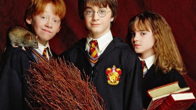 Rupert Grint, Daniel Radcliffe et Emma Watson dans le premier volet de la saga tirée des livres de J. K. Rowling.