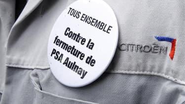La ligne de production sur le site PSA Peugeot Citroën d'Aulnay-sous-Bois a été arrêtée vendredi et un millier de salariés ont débrayé et manifesté sur le site de Rennes au lendemain de l'annonce par le groupe de la suppression de 8.000 postes et de l'arr