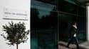 Devant le Parlement, à Nicosie. Le Parlement chypriote a rejeté mardi soir à une large majorité le projet de loi sur la taxation des comptes bancaires, condition du déblocage d'une aide financière internationale de 10 milliards d'euros. /Photo prise le 19