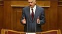Le Premier ministre grec George Papandréou. Les députés grecs ont adopté mercredi le premier des deux volets du plan d'austérité destiné à éviter la faillite financière de la Grèce, un plan dénoncé par de nombreux Grecs qui ont encore manifesté par millie