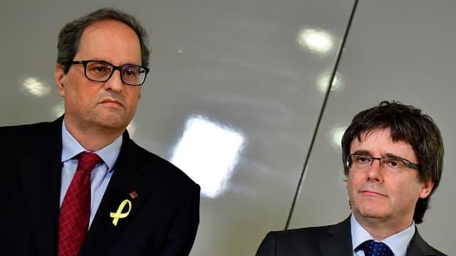 Le nouveau président de la Catalogne, Quim Torra et Carles Puigdemont à Berlin le 15 mai 2018.