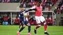 Axel Disasi (Reims) au duel avec Kylian Mbappé