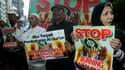 Protestation à Djakarta contre le projet d'une église de Floride qui veut brûler un exemplaire du Coran pour l'anniversaire des attentats du 11-septembre. De hauts dignitaires religieux américains se sont joints mardi à la condamnation de cette initiative
