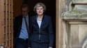 Theresa May veut lutter contre l'optimisation fiscale des géants américains. Philip, son mari, travaille pour un fonds californien qui possède des milliards d'actifs d'Amazon et de Starbucks.