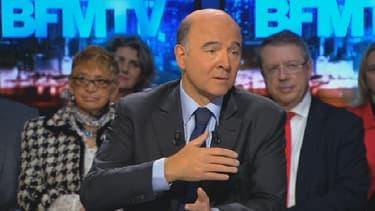 Pierre Moscovici, le ministre de l'Economie, était l'invité de BFM Politique ce 8 décembre