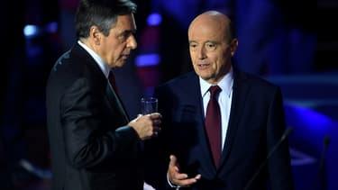 Alain Juppé et François Fillon lors du deuxième débat de la primaire à droite.