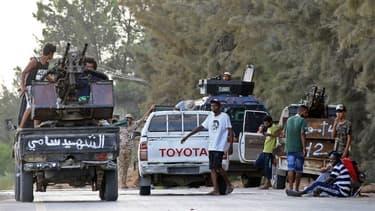 Des combattants dans Tripoli.