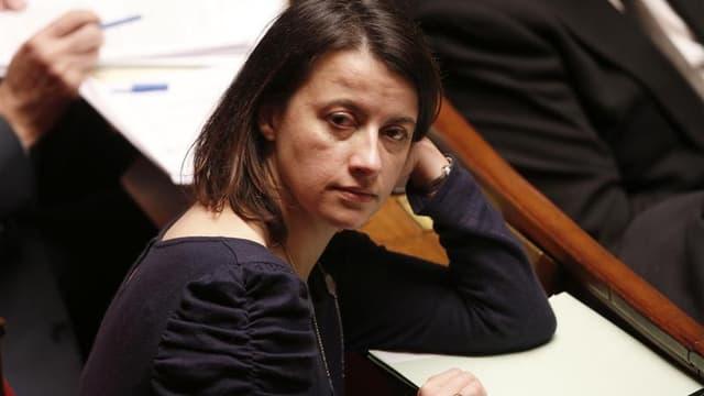 """La ministre du Logement, Cécile Duflot, a assuré qu'elle souhaitait """"sortir de la solution hôtelière"""" et utiliser tous les dispositifs disponibles pour loger des familles menacées d'expulsion dans des hôtels parisiens. """"Une trentaine de famille n'ont pas"""