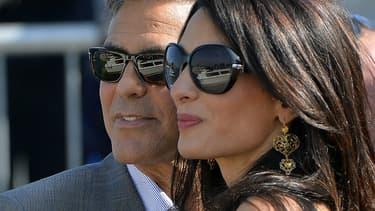 George Clooney et sa fiancée Amal Alamuddin, le 26 septembre, à quelques jours de leur mariage à Venise.