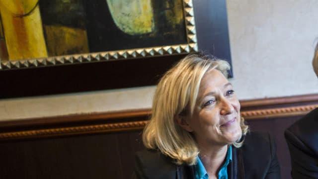 La présidente du Front National et son trésorier Wallerand de Saint-Just en conférence de presse à Paris en 2014