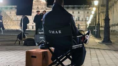 """Omars Sy sur le tournage d'""""Arsène Lupin"""" à Paris."""