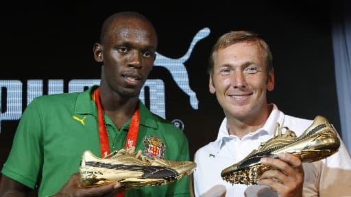 Usain Bolt en compagnie du président de l'époque, Jochen Zeist, en 2008.