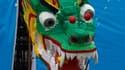 A Jiangmen, dans le sud de la Chine, le concours d'hommes volants draine de plus en plus de Chinois, les incitant à faire preuve d'imagination pour concevoir des machines farfelues susceptibles de voler le plus longtemps possible au-dessus d'un lac. /Phot