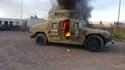 Un véhicule des forces de sécurité irakiennes à Mossoul, le 10 juin 2014.