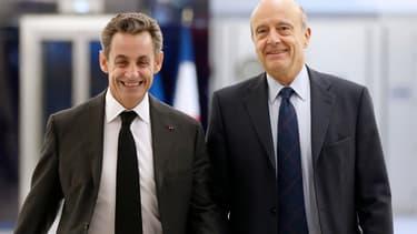 Nicolas Sarkozy et Alain Juppé, fin 2014 au siège de l'UMP à Paris, quelques jours après l'élection à la présidence du premier cité